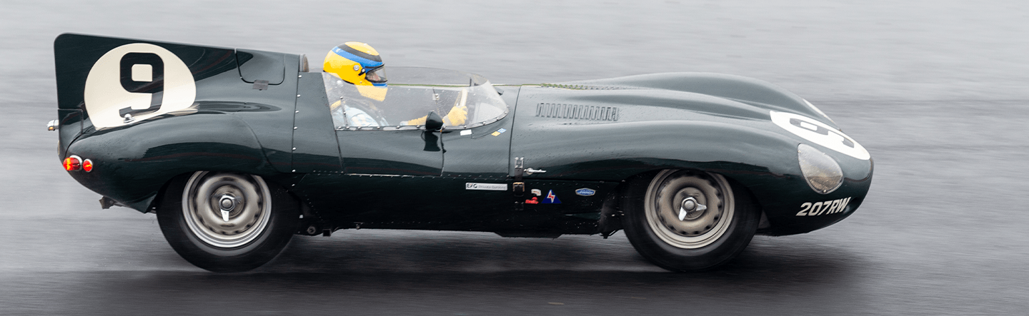 Jaguar D-Type at speed on the Wellington Straight. (c)Simon PR Benson - sprbphoto.co.uk