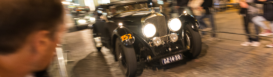 Bentley at speed through Parma during the Mille Migila